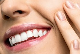Woman with a beautiful smile from cosmetic dentist in Grammercy Park.