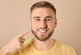 man showing off straight teeth